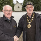 John O'Sullivan, PRO of Duhallow Vintage Club congratulating club President Bill Neale on wearing their new chain of office donated by the Collins family prior to their Spring Run last Sunday