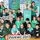 Senior Infants at Gael Scoil Thomáis Dáibhís in Mallow met Irish Rugby Team member Anna Caplice when the Women's Rugby Cup Trophy Tour stopped off at their school