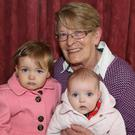 Lil Fleming with her grand daughters Katie and Róisín enjoying the Alzheimer's Tea Morning hosted by Tureencahill Actively Retired Group as part of the Bealtaine Festival