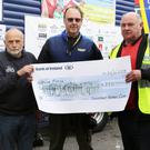 Jack Sheehan and Donie Lucey presenting a cheque on behalf of Millstreet Vintage Club to Peter Plehov and Phil Gibson from Leicester in the UK who are currently undertaking the Blue Force 5,000 mile Coastline Tractor Challenge