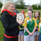 Former Cork ladies football star Deidre O'Reilly relates to the Meelin players on the occasion when accepted the trophy, after helping Lismire win at the Duhallow Schools Football Finals
