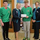 Lisa O'Shea, Manager at Bank of Ireland, Kanturk, and Siobhan O'Sullivan, Youth and Community Officer, making a presentation to Ciarán Carroll, Captain of the U14 Cúchulainn (Kanturk) Hurling Team ahead of their trip to the Féile na nGael competition last weekend. Also included are team members Jack Sheahan, Matthew Hooton, Luis O'Mahony, and Brandon Hogan. Photo by Sheila Fitzgerald