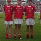 Cian Dennehy, Mourneabbey (Burnfort NS) and Patrick O'Grady Killavullen (Ballygown NS) and Ted Twomey, Grenagh (Rathduff NS) who took part in the Primary Game at half time during the Munster Football Final in Killarney