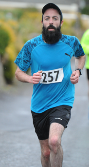 Pa Morrissey from Cecilstown completes the Castlemagner Road Run