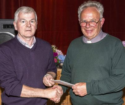 Michael J. O'Regan representing Freemount GAA Club making a presentation to Fr. Padraigh Keogh to mark his retirement as PP of Milford Parish at a reception in Freemount