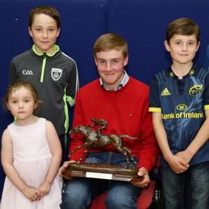 Local Jockey David Noonan pictured with young fans Grace, Jack, Conor, and Jamie Harrington during a reception hosted in his honour by the Community Council at Kilbrin Social Club