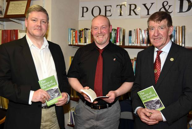Author Peter Keating (centre) pictured with his brother John and Cllr. Ian Doyle at the launch of his book 'The Green of Spring' at Charleville Library