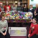 Boherbue Comprehensive School St. Vincent de Paul Fundraiser: The Student Council officers were thrilled to present the proceeds from their recent Christmas Jumper and Food Drive appeal to local representatives, and past teachers in the school, Ms. Rose Murphy and Ms. Helen Walsh. Pictured are, front row: Melanie Browne and Tara O'Keeffe; back, from left: Teresa Kelly, Eimear Collins, Eva Feehan, Hannah Meaney, Roisin Murphy, Matthew McHale, MS. Heelan, Rose Murphy and Helen Walsh (SVP Representatives).