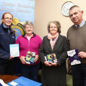 Betty Kiely and Kitty Mitchell, Kanturk, chatting to Garda Kathryn Canty and Sergeant John Kelly at the Kanturk and Newmarket Garda Sub Districts Community Alert Meeting at the Edel Quinn Hall, Kanturk. Photo by Sheila Fitzgerald