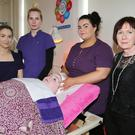 Tutor Paula O' Connor with students Sara Shanahan, Cáit O' Callaghan, Chloe Golden and Alvita Matuleviciute in the Beauty and Body Therapy Department during Mallow College Open Day