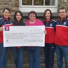 Freemount Macra members presenting €2,750 to the Down Syndrome Centre Cork from the proceeds of their recent tractor run