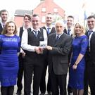 Alan Finn,the leader of the Shandrum Céilí Band presenting Gerry Murphy a copy of the CD, the 'Boss Murphy Music Legacy', at the launch of the CD at St Mary's Church, Buttevant. Also pictured are band members