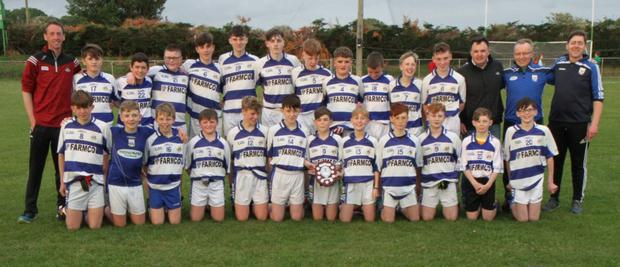 The winning Killavullen U14 Football team who won the Under 14 B1 Football League Final. They're pictured with their mentors and coaches, John Hannon, Mick Rea, Kevin Lillis and Greg Fennell