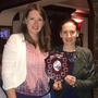 Helena Coughlan, left, accepting the Avondhu NTC Ballad Group plaque from Marie Murphy, right