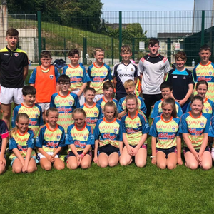 Niall O Leary, Cork Senior hurler with coaches and some participants at the Cúl Camp in Killavullen, last week