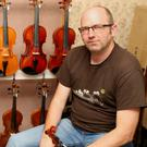 Chris Murphy, Rathcoole, (right), pictured with a selection of his Fiddles at Scully's Fest. Also included is Jack Murphy and Musician/Composer John Walsh from Kanturk