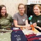 Eileen Daly, Éilish Hourigan and Teresa O'Sullivan of Blackhut Crafts putting the finishing touches to the Scully's Fest T Shirts