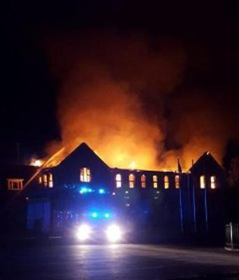 Flames leaping from the blazing Patrician Academy building in July 2016.
