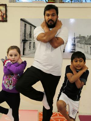 Juliet and Stephen doing the 'Tree Pose' with Yoga Teacher Simon Pachikara at the Boherbue Traditional Indian Yoga Centre