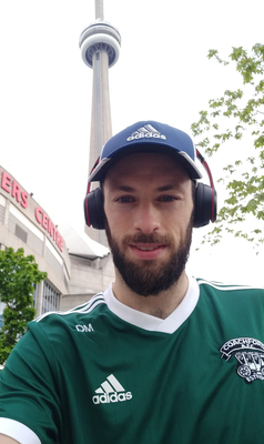 Coachford AFC's Dhani Merrick outside the Rogers Centre in Toronto during his leg of the fundraising run