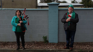 Pipeband members Alison Fitzpatrick and Donie Forde who played in the Car Park on St Patrick's Day