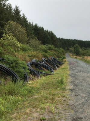 Piping from the proposed water mains replacement scheme left by the side of the road after the project twas shelved