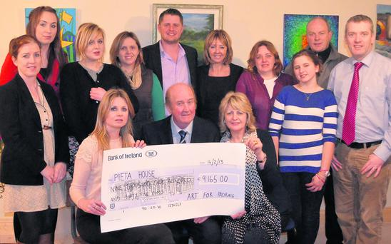 The Horgan family and committee members Fidelma Nolan and Jack Neenan presenting the cheque of 9,165 to Joan Freeman and Ciaran O'Brien of Pieta House.
