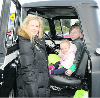 Paula, Lilly and Kelly Hartnett in theri father Tom's F100 Ford Pick-up truck that participated in the St. Patrick's Day Parade in Charleville.