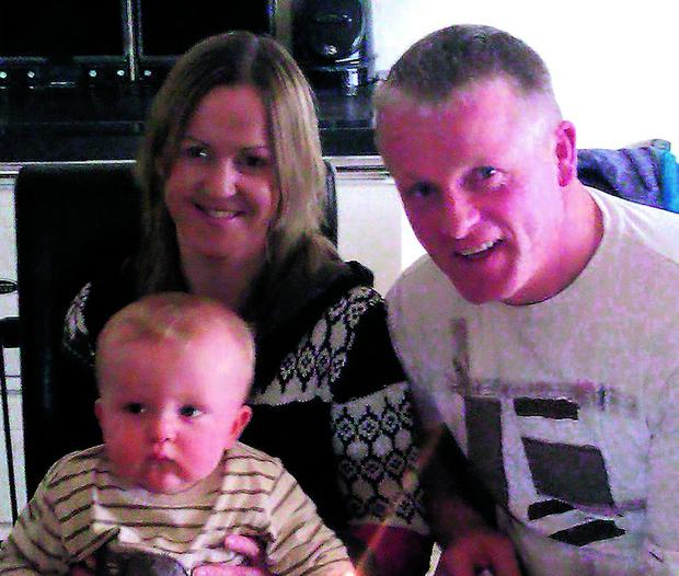 Connie Twomey, Meelin, who passed away last Friday, pictured with his wife Elber, and little son Oisín who died in the crash last July.
