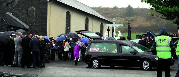 n The funeral cortege leaves St Joseph's Church, Meelin, on Tuesday.