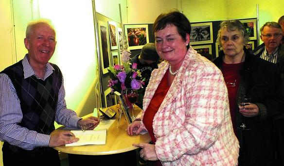 Family relation Ina O'Regan having her booked signed by author Gerard O'Callaghan at the launch last Friday.
