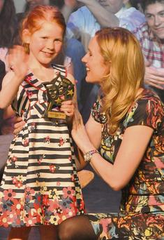 Zelda Hickey recieving Theatre Tot of the year award from her teacher Aine O'Connor.