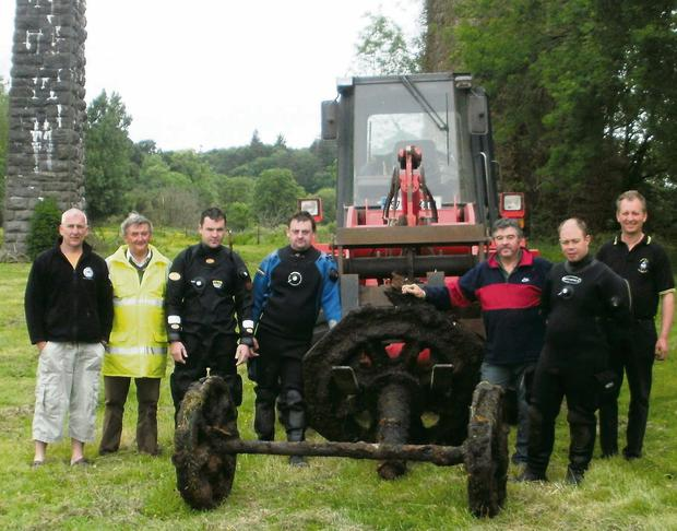 Blackwater Sub Aqua divers with the parts of the railway carriage discovered in the river beneath the Carrigabrick Viaduct, Fermoy.