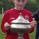 Luke Casey, Coachford, with the All-Ireland Schoolboys Under-12 trophy.