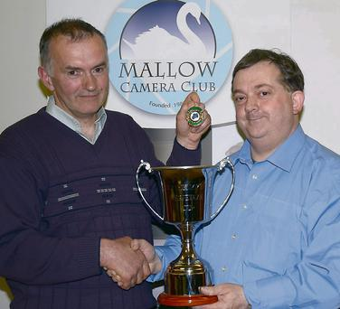 Bill Power receiving his award from Neily Curtin, Competition Secretary, Mallow Camera Club. Photo: Patrick T Sheehan.