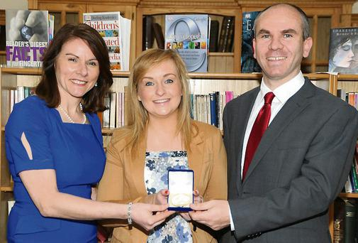 Fiona Twomey at the Department of Education, with school principal Ann Doherty and her teacher Ger O'Donovan.