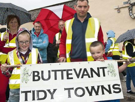 Gavin Gearin, Richie and TJ McCarthy getting ready to protest in Buttevant last Friday at the state of the main street in Buttevant. Photo by Bernadette Hayes