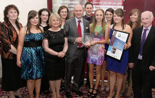 Rathmore Social Action Group, winners of the Best Community Enterprise Award at the inaugral Duhallow Business Awards 2013 at the James O'Keeffe Institute, Newmarket receive their prize from Brendan Malone, editor, The Corkman.