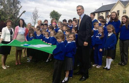 Pupils and staff of Kilmagner National School proudly display their second Green Flag.