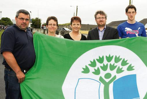 Pictured at the raising of the fifth Green Flag for biodiversity achieved by St. Joseph's Foundation Charleville were John O'Shea, Mary Hayes and Helen Power, St. Joseph's, Michael John O'Mahony, An Taisce and Nicky Quaid who raised the flag.