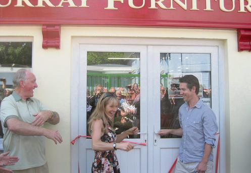 Sharon Shannon cuts the ribbon at the official opening of musician Jim Murray's new Furniture Store in Macroom.