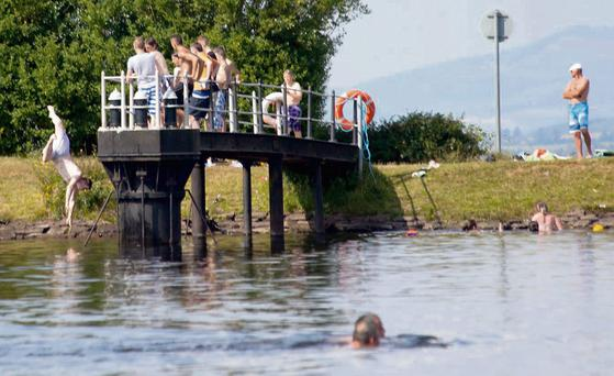 Swimmers cooling off at Fermoy reservoir. Photo: Dermot Fitzgerald