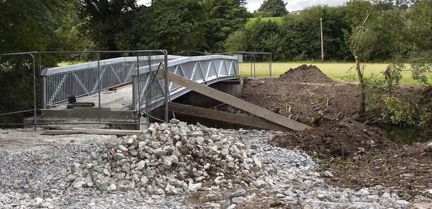 Work on the new footbridge linking the Castle Grounds and Tom Creedon Park is nearly complete. Photo by John Delea