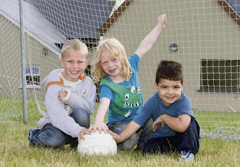 Goal-den Boys: Cian Kelleher, 5, Sam Cussan-Walsh, 5 & Adam Al Kafage, 4 check out the football pitch at Muinefliuch NS.