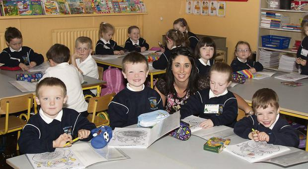 All Smiles: Killian Healy O'Brien, 5, Taylor Connolly, 5, Teacher Mrs Sheahan, Ciara Buckley, 4 & Brian Bradley, 4 starting their first day at School in Clondrohid NS.