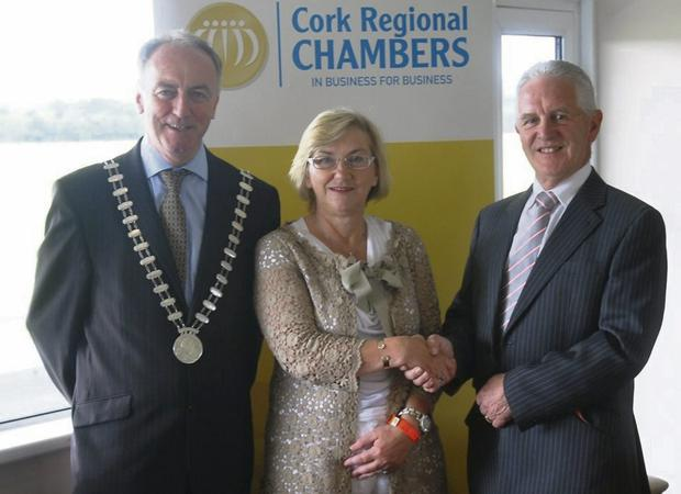 Passing the baton: outgoing chairperson of Cork Regional Chambers Maura Hunter hands over to incoming chair Donal KelleherDonal, of Kelleher & Associates Ltd, Midleton under the watchful eye of county mayor Cllr Noel O'Connor, Mallow.