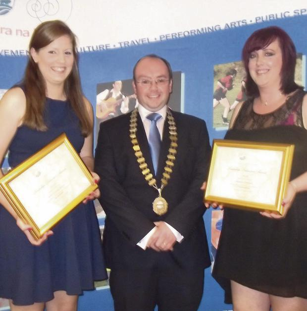 Receiving their Leadership Awards at the West County Hotel in Ennis Co. Clare on Saturday night from National President Kieran O'Dowd were Sarah-Louise Healy (left) and Rebecca Enright.
