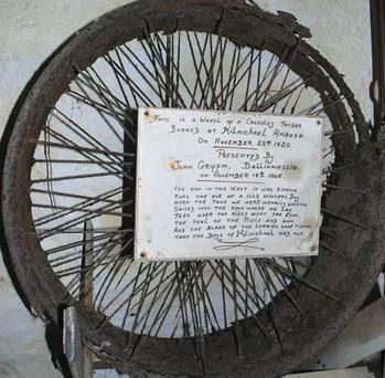 Inside the Terence MacSwiney Memorial Museum - this artefact is the wheel of a British army Crossly Tender recovered, burned, from the site of the Kilmichael ambush.