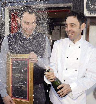 Richard and Duncan Blair of Blairs Inn, Cloghroe, Blarney, Co. Cork celebrate after winning the Georgina Campbell Ireland Pub of the Year 2014 award. (Photo: Billy macGill)