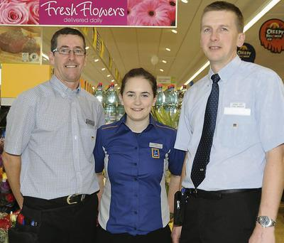 Staff members Garrett McDonagh, Emma Cremin and manager Shane Liddy.